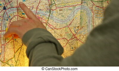 London Navigator - Man navigates map with fingers