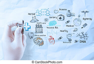 hand hold  stethoscope showing medical concept on crumpled paper background