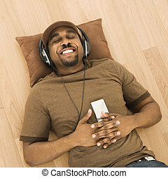 Man relaxing to music.