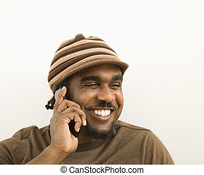 Man on cell phone. - African-American mid-adult man wearing...