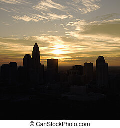 Sunset in Charlotte, NC - Sunset silhouetting aerial view of...