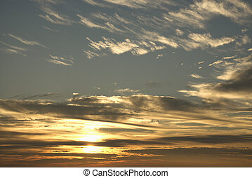 Sunset sky with clouds - Sun in blue sky with clouds