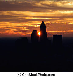 Charlotte, North Carolina - Sunset silhouetting aerial view...