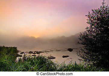 Colorful misty dawn at the lake