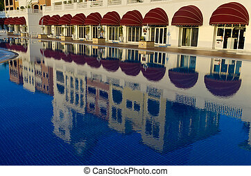 Reflection of hotel in the pool in Turkey