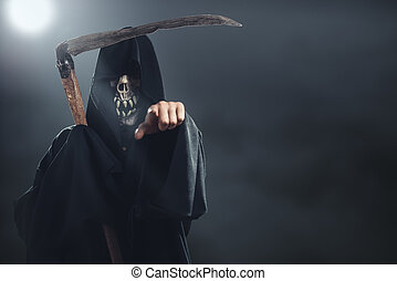 death with scythe standing in the fog at night and points to...