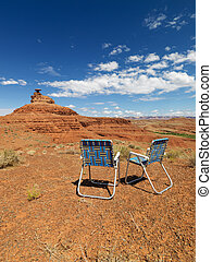 Lawn chairs in desert. - Two outdoor lawn chairs in scenic...