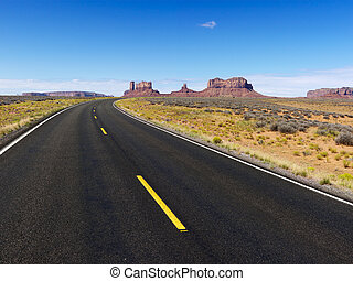 Scenic desert road. - Remote desert road with mountain land...