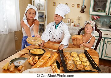 Happy children cooking homemade pastry
