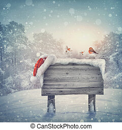 Wooden sign in winter forest - Wooden sign and santa hat in...