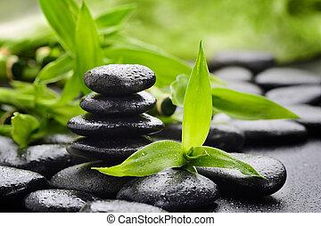 zen stones - zen basalt stones and bamboo on the black