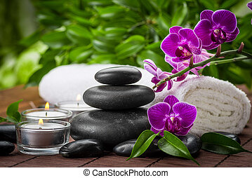 spa still life - zen basalt stones and orchid on the wood