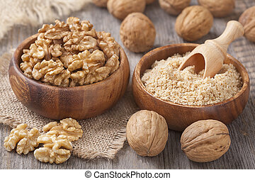 Walnuts in wooden bowls
