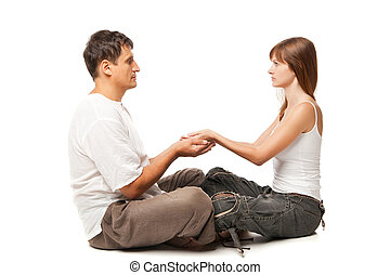 Healthy couple in yoga position on white