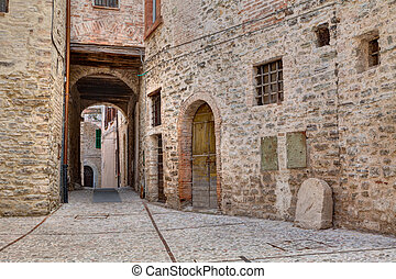 antique alley in Spoleto, Umbria, Italy - a picturesque...