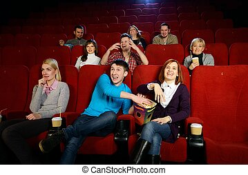 Group of young people watching movie in cinema