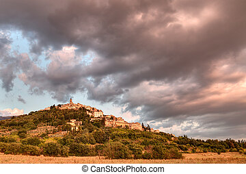 Italian hilltown Trevi - landscape at sunset of the town on...