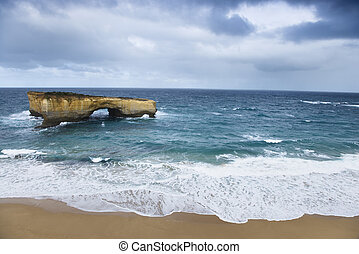 Landform in ocean - Rock formation in arch shape as seen...