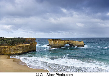 Landform at coast. - Rock formation in arch shape as seen...