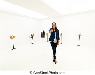 female reporter at art exhibition opening
