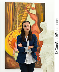 viewing works of art - cropped view of woman standing in a...