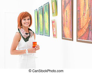gallery owner at exhibition opening - one beautiful...