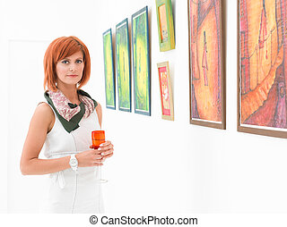 female artist at exhibition opening - young beautiful...