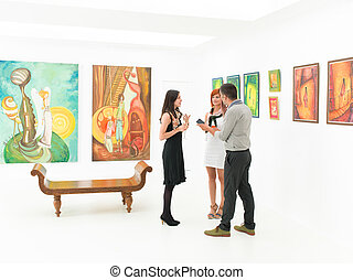 artist being interviewed - young caucasian woman being...