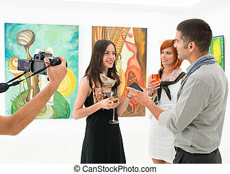 female artist talking about her works - woman being...