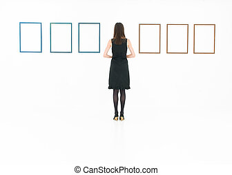 stylish woman looking at empty frames