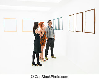 group of people contemplating artworks - group of people...
