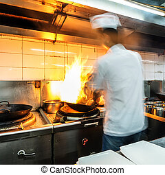 Chinese chef - Crowded kitchen, a narrow aisle, working chef...
