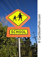School crosswalk sign. - Low angle view of School crosswalk...