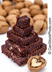 Lots of brownies - One pyramid of brownies with walnuts on a...