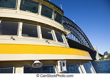 Ferry by bridge. - Detail of ferryboat in Sydney Harbour...