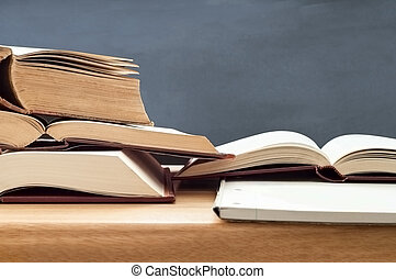 Study Books Opened on Table - Education shot of stacked old...