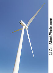 wind turbine against partly blue sky