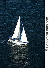 Sailboat sailing. - Aerial view of sailboat at sea in...