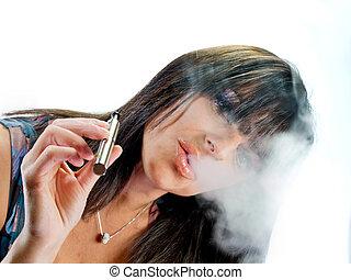 brunette girl smoking electronic cigarette - brunette...