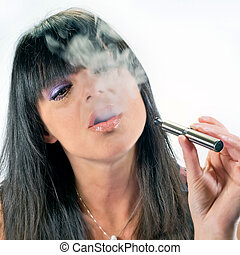 brunette girl smoking electronic cigarette - brunette...