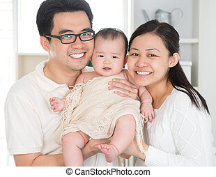 Asian family - Portrait of Asian parents and six months old...