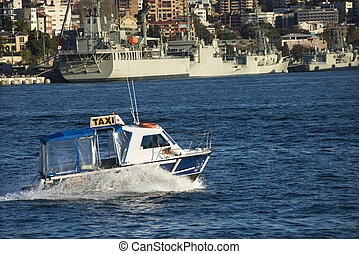 Water taxi, Australia. - Water taxi and view of buildings...