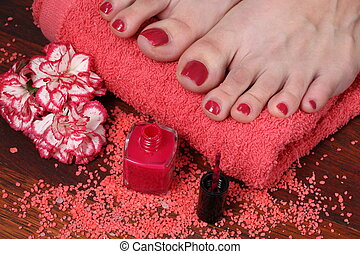 Pedicure in the spa salon - Well-groomed female feet on...