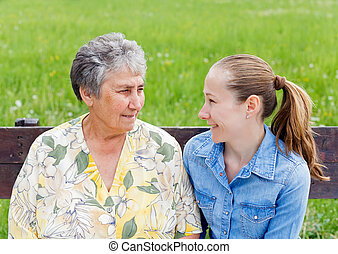 Elderly care - Elderly woman tells a story to her daughter
