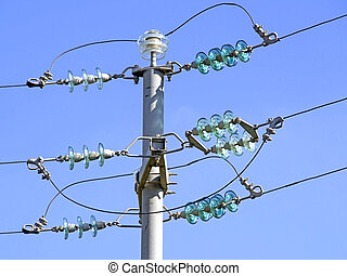Current pole with insulators, blue sky
