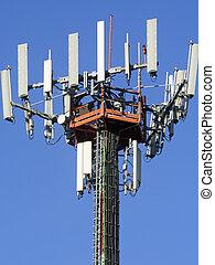 telephone antennas pylon , blue sky - big telephone antennas...