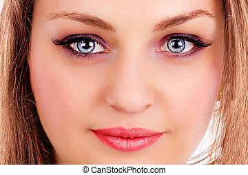 Face of a beautiful young woman with blue eyes