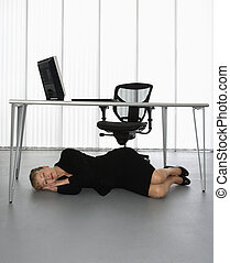 Businesswoman napping - Caucasian businesswoman sleeping on...