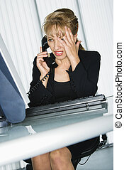 Frustrated businesswoman - Caucasian businesswoman with hand...