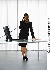 Office worker. - Back view of Caucasian businesswoman...